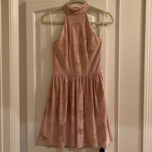 Nude high-neck, open-back dress